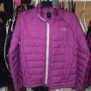 A purple North Face Jacket
